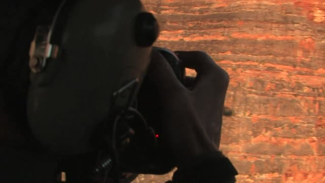 man photographing the bungle bungle range from a helicopter, australia. editorial use only. - viewpoint stock videos & royalty-free footage