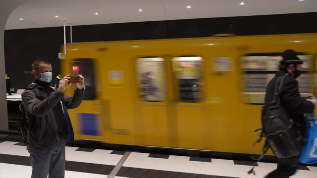 vídeos de stock e filmes b-roll de man photographs a u5 subway train departing from rotes rathaus station on the new extension of the u5 line on the extension's opening day during the... - rathaus