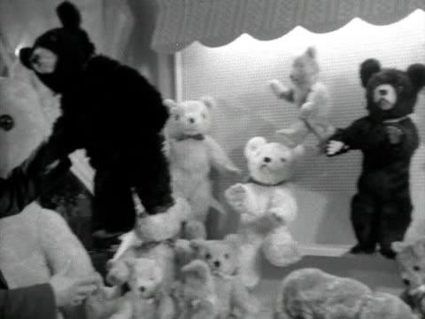 A man picks up a teddy bear at a toy fair in Brighton