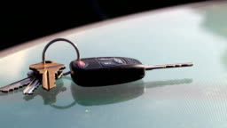 Man picks up car keys from restaurant table in summer
