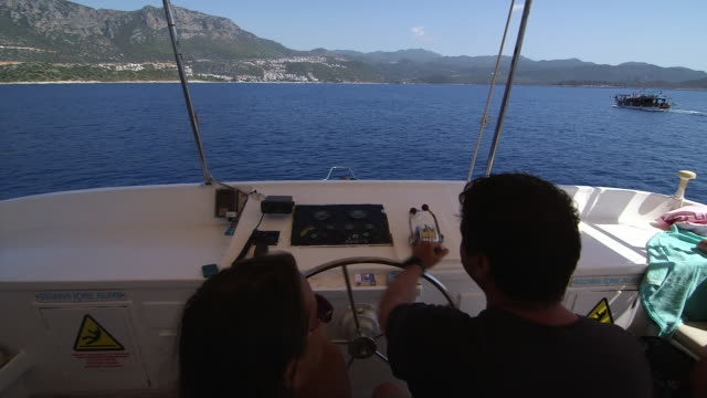 ots man piloting boat - wiese stock videos & royalty-free footage
