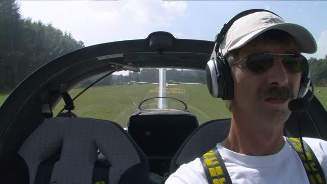 MS Man piloting sailplanes at airport / Konz-Koenen, Mosel-Valley, Rhineland-Palatinate, Germany