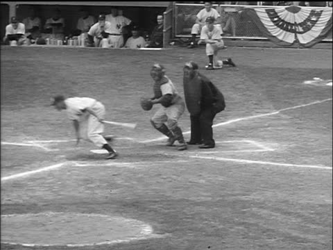 man pitching ball, batter hitting + running to first base, out / pitcher is mobbed - 1955 stock-videos und b-roll-filmmaterial