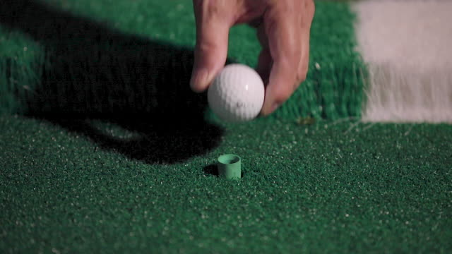 a man places a golf ball on a tee - golfer stock videos & royalty-free footage