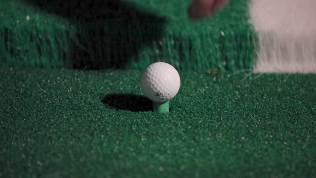 a man places a golf ball on a tee - driving range stock videos & royalty-free footage