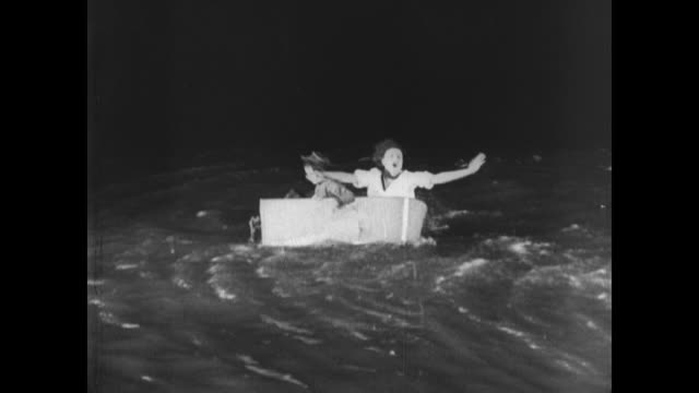 1921 Man (Buster Keaton) places family in lifeboat but remains frustrated and out of ideas on his sinking boat