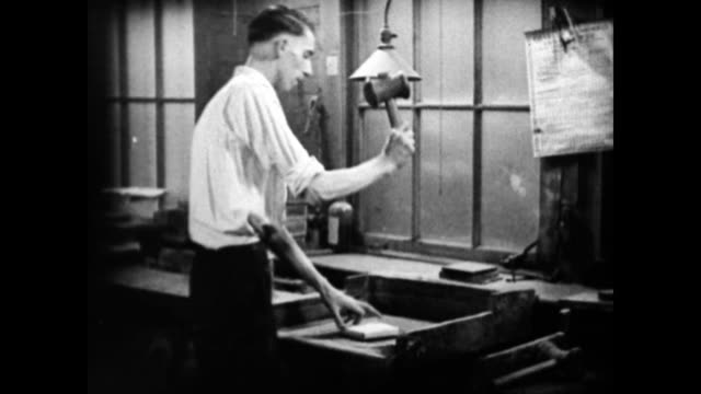 man places thin squares of gold sheet into a pile / man binds the sheets together and proceeds to hammer them / man removes the cover to show the... - gold leaf stock videos & royalty-free footage