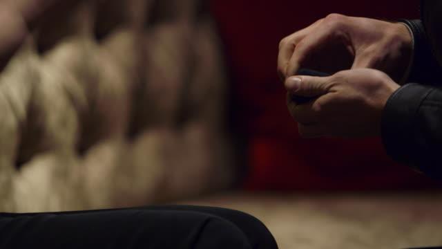 cu man placing engagement ring onto womans finger - finger stock-videos und b-roll-filmmaterial