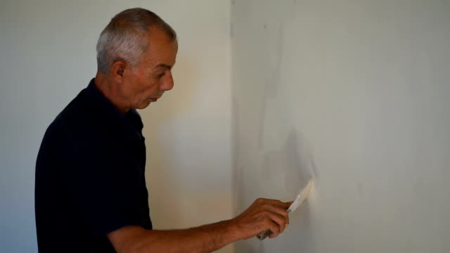 man plastering wall - hsyncoban stock videos and b-roll footage