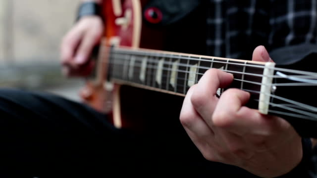 man playing a guitar - electric guitar stock videos and b-roll footage