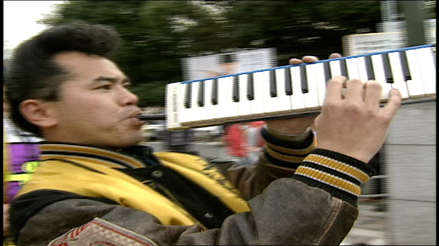 man playing a piano horn in in band in harajuku japan - rock group stock videos & royalty-free footage