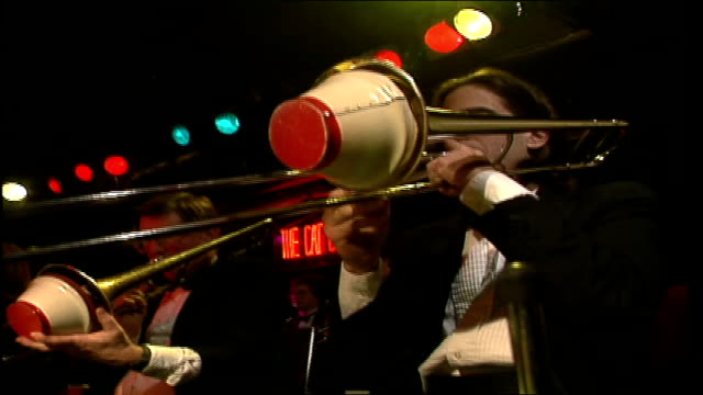 cu man playing a trombone with bell cover - trombone stock videos & royalty-free footage