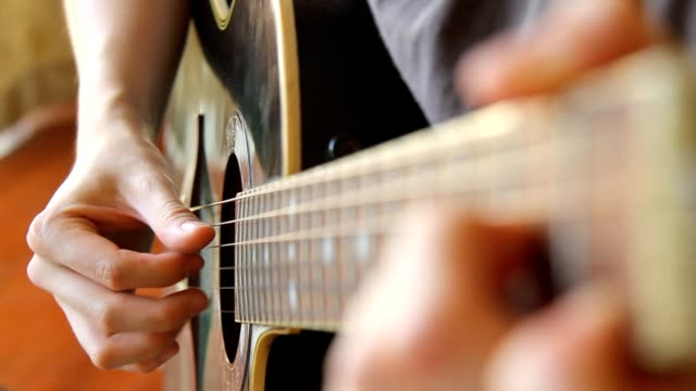 man playing acoustic guitar in picking finger style - close up view - plucking an instrument stock videos and b-roll footage
