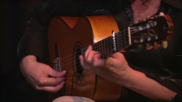 cu tu man playing acoustic guitar, madrid, spain - flamenco stock-videos und b-roll-filmmaterial