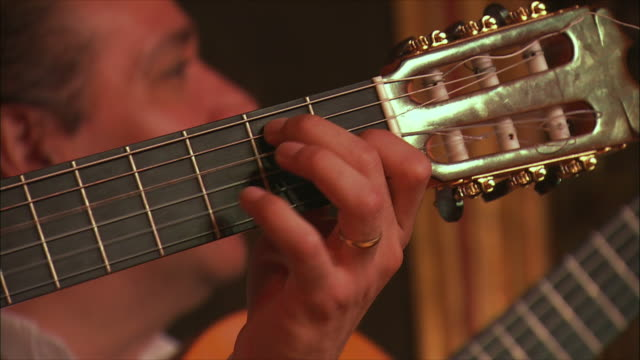 cu man playing acoustic guitar, madrid, spain - flamenco stock videos & royalty-free footage