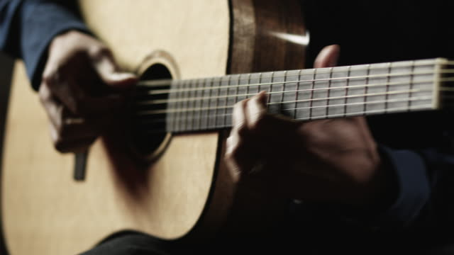 cu man playing acoustic guitar / provo, utah, usa - provo stock-videos und b-roll-filmmaterial