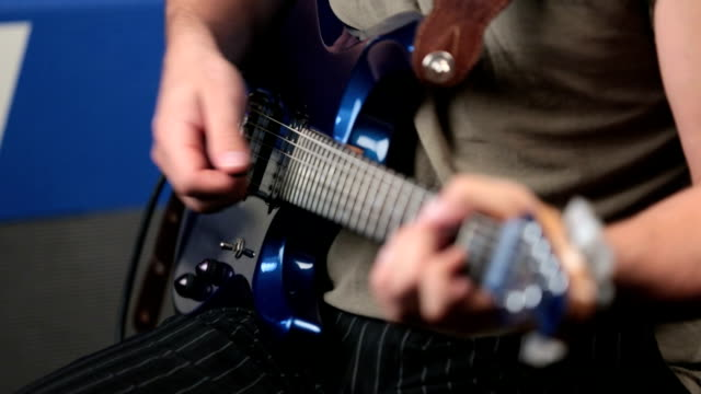 man playing an electric guitar - electric guitar stock videos & royalty-free footage
