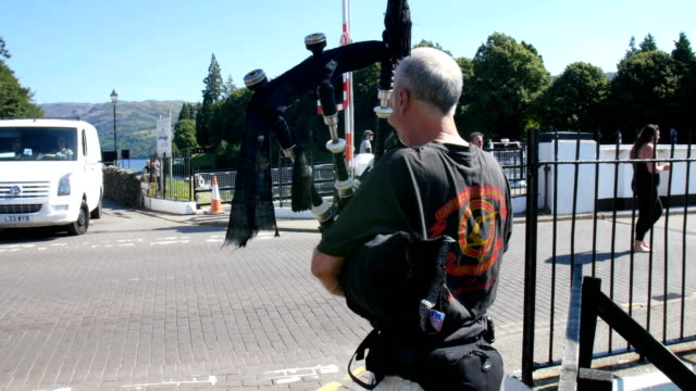 A man playing Bagpipe Fort augustus, Scotland