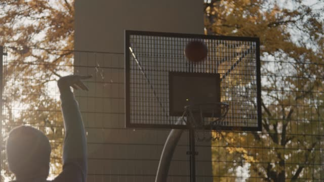 man playing basketball on sunny day - loss stock videos & royalty-free footage