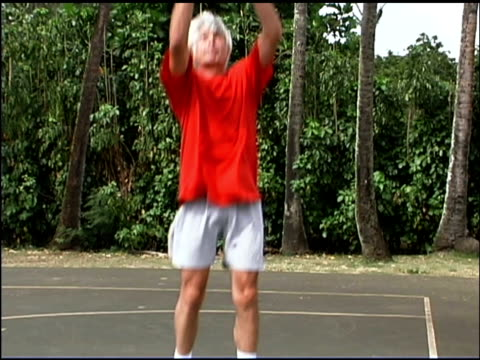 man playing basketball - one mature man only stock videos & royalty-free footage
