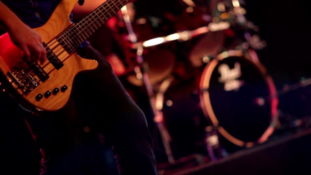 stockvideo's en b-roll-footage met man playing bass guitar at concert in local bar - bar tapkast