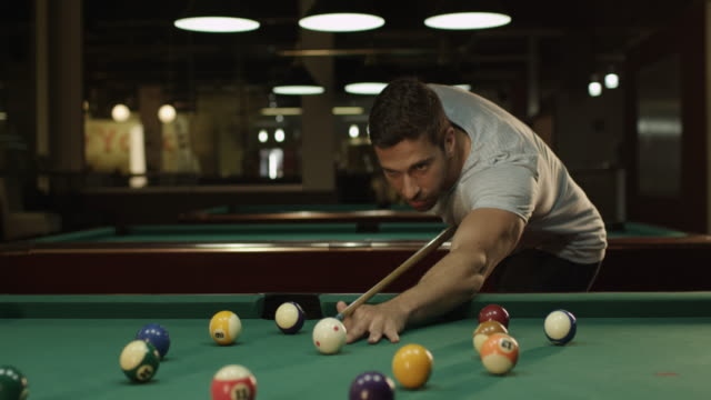 Man playing billiard (snooker)