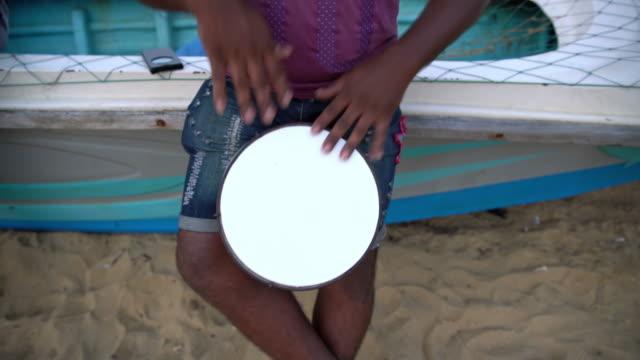 MS Man playing bongo drum