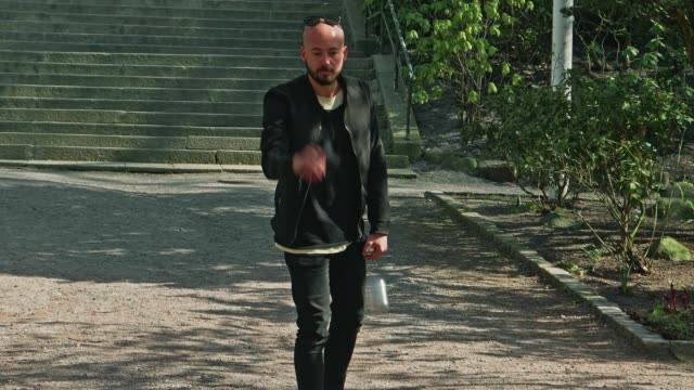 Man playing boule in park