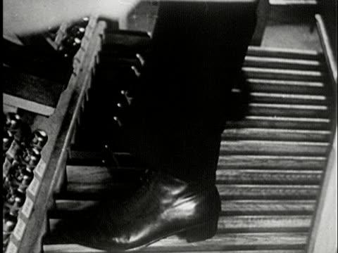 CU, B/W, COMPOSITE, Man playing church organ, USA