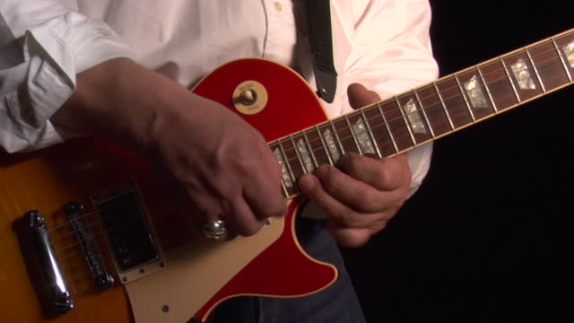 cu, man playing electric guitar, mid section - electric guitar stock videos and b-roll footage