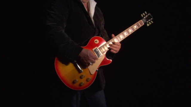 cu, zi, man playing electric guitar, mid section - electric guitar stock videos and b-roll footage