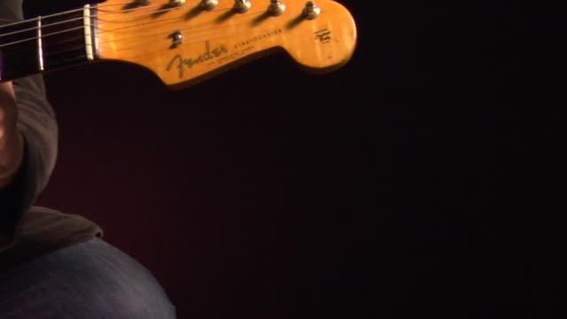 CU, PAN, Man playing electric guitar