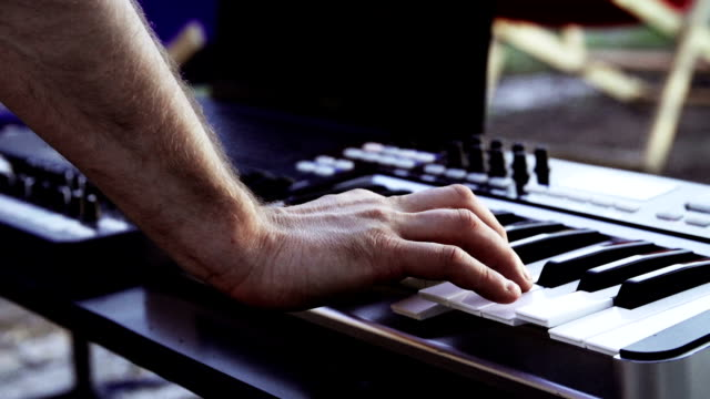 Man playing electric keyboard. Outdoor party