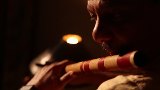 Man playing flute, Delhi, India