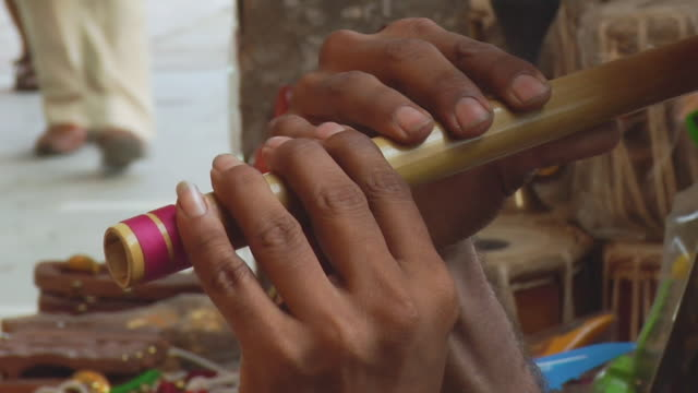 cu zi man playing flute outside the connaught place / delhi, india  - woodwind instrument stock videos and b-roll footage