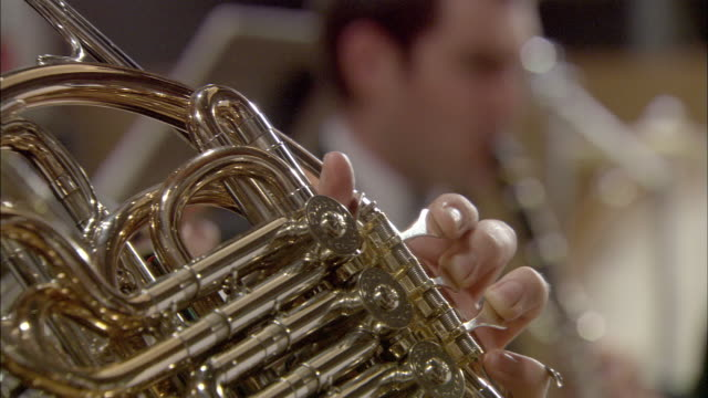 cu man playing french horn / london, united kingdom - french horn stock videos and b-roll footage