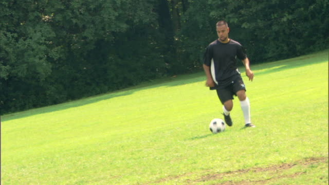 man playing game of soccer - see other clips from this shoot 1281 stock videos and b-roll footage
