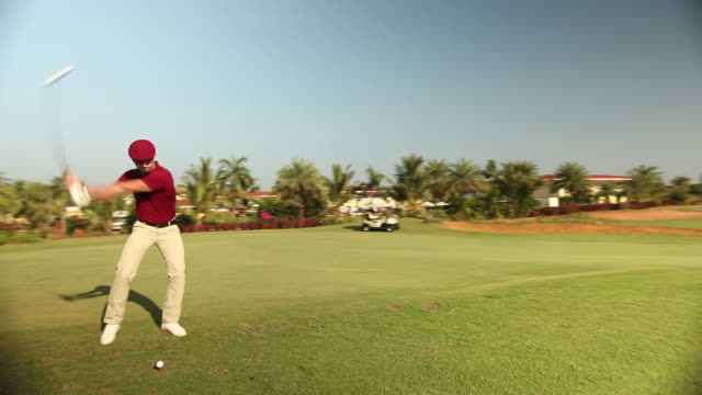 Man playing golf in a golf course