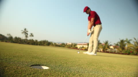 man playing golf in a golf course  - putting stock videos & royalty-free footage