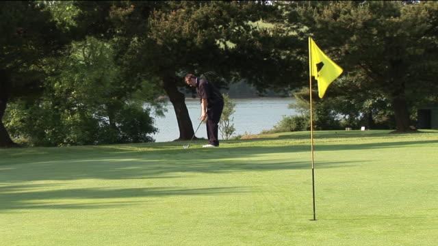 ms, man playing golf, kinsale, ireland - golf ball stock videos and b-roll footage