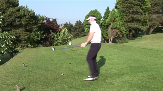 ms, man playing golf, kinsale, ireland - sun visor stock videos and b-roll footage