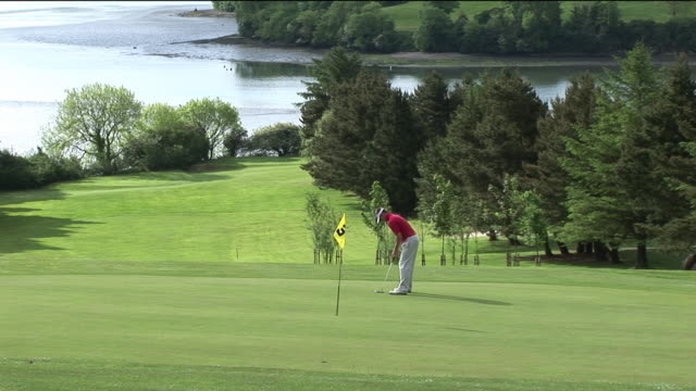 ws, man playing golf, kinsale, ireland - teeing off stock videos & royalty-free footage