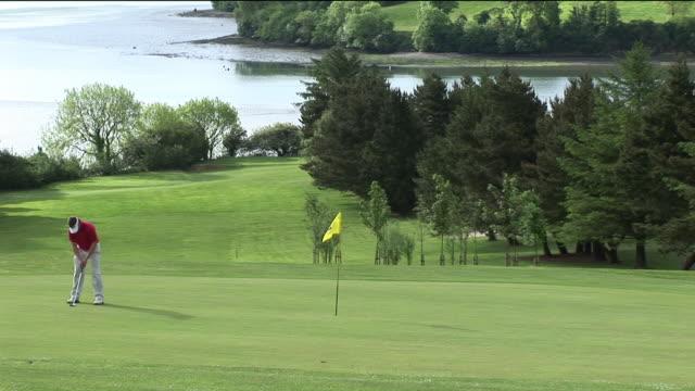 WS, Man playing golf, Kinsale, Ireland