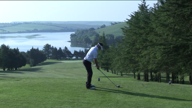 ms, man playing golf, kinsale, ireland - teeing off stock videos & royalty-free footage