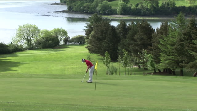 ws, man playing golf, kinsale, ireland - one mid adult man only stock videos & royalty-free footage