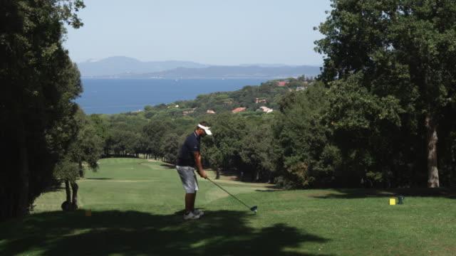 WS Man playing golf / Punta Ala, Italy
