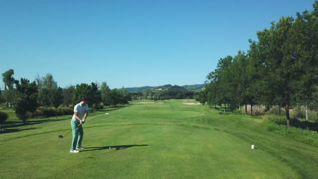 man playing golf - wide shot stock videos & royalty-free footage