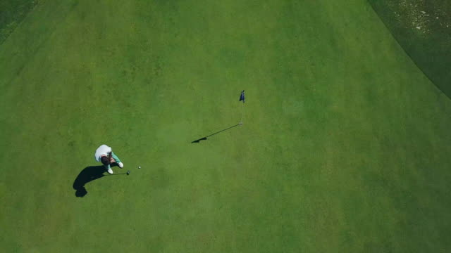 man playing golf - putting green stock videos & royalty-free footage