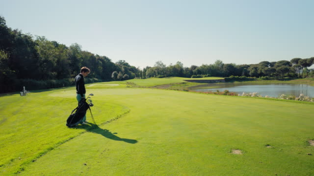 man playing golf - one mid adult man only stock videos & royalty-free footage