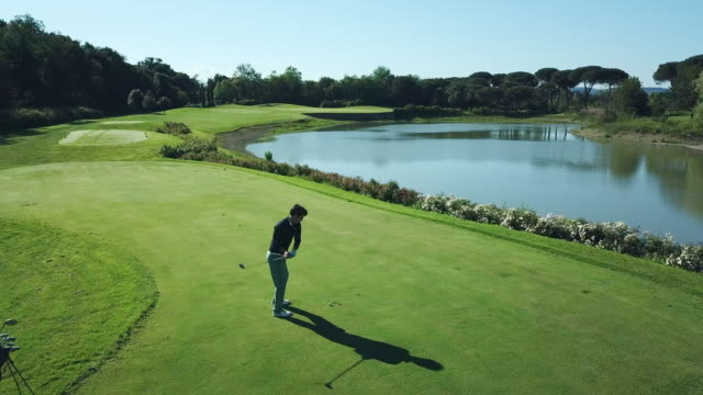 man playing golf - pond stock videos & royalty-free footage